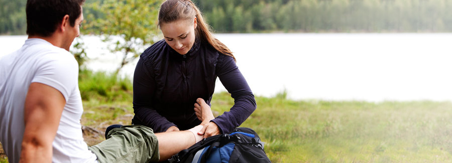 A woman showing the best exercises for ankle sprain treatment